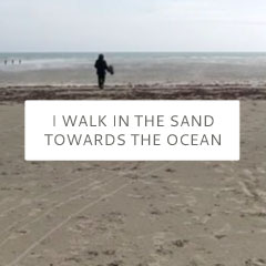 I walk in the sand towards the ocean